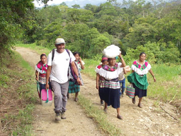Juan Manuel walking with indigenous women